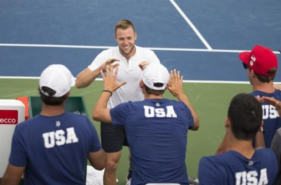 Jack Sock celebrates with his U.S. teammates after his win over Marin Cilic in previous Davis Cup competition.